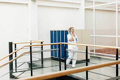 Female doctor on the phone - p312m2174713 by Scandinav