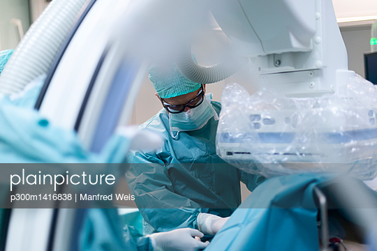 Interventional radiologist at work - p300m1416838 by Manfred Weis