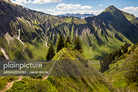 Germany, Bavaria, View into a valley in the Allgäu Alps - p834m2259063 by Jakob Börner