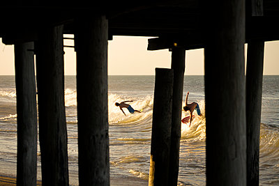 Surfing in the Outer Banks - p343m1111909 by Wray Sinclair
