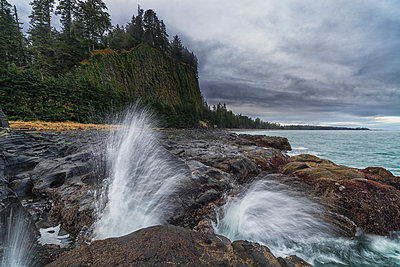 Water explodes through the blow hole near Tow Hill on the North shore of Haida Gwaii, Naikoon Provincial Park; British Columbia, Canada - p442m1085192f by Robert Postma