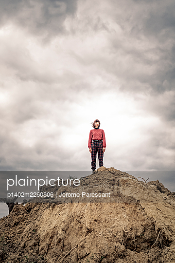 Girl on soil mound - p1402m2260806 by Jerome Paressant