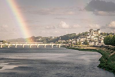 Rainbow over Pont Cessart at Saumur, France - p1402m2206208 by Jerome Paressant