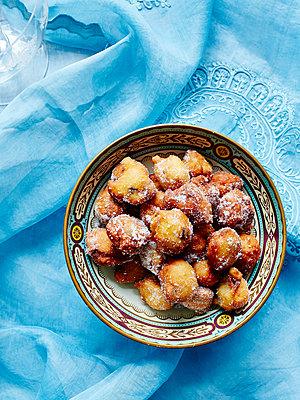 Still life with bowl of Italian fritole - p429m1012878f by BRETT STEVENS