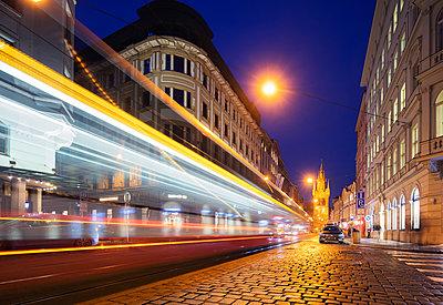 City tram lights heading towards The Powder Tower, Old Town, Prague, Czech Republic, Europe - p871m1584078 by Christian Kober