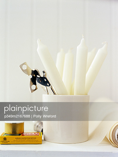 Can opener and candles with matches. - p349m2167688 by Polly Wreford