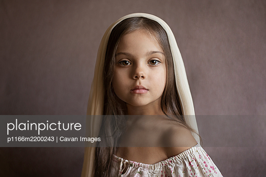 A girl with her hair down and a handkerchief on her head - p1166m2200243 by Cavan Images