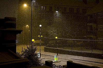 Road at night with snowfall - p3882483 by Ulrike Leyens