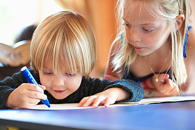 Close up of children drawing indoors - p42917537f by Ghislain & Marie David de Lossy