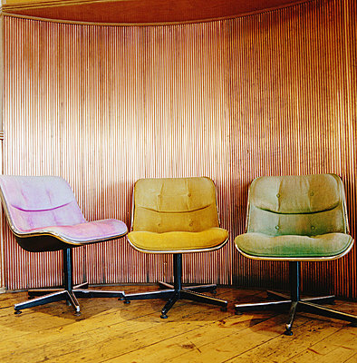 3 retro chairs in a old scene - p4295648 by Philip Lee Harvey