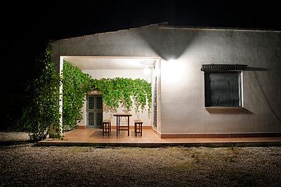 Side of holiday apartment at night - p1072m829282 by Neville Mountford-Hoare