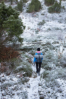 Woman hiking during winter - p352m1523523 by Andreas Ulvdell