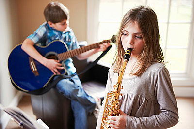 Children playing music together - p429m800807f by Adie Bush