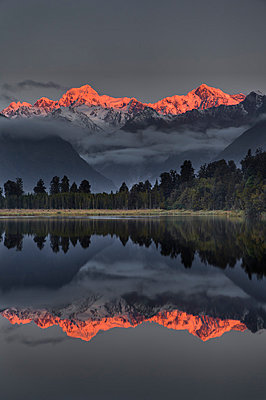 Sunset reflection of Lake Matheson with Mount Tasman and Mount Cook - p884m863965 by Colin Monteath/ Hedgehog House