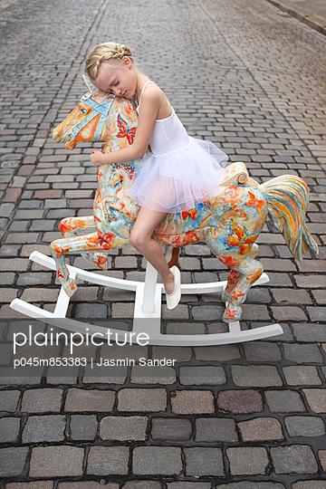 Girl on her rocking horse - p045m853383 by Jasmin Sander