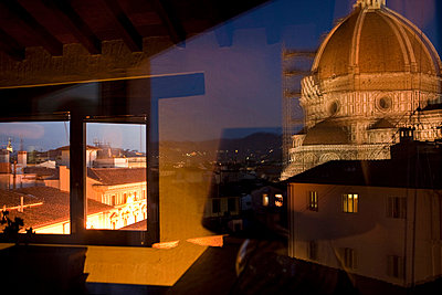 Santa Maria del Fiore or Duomo reflected in a window at night - p3314070 by Andrea Alborno