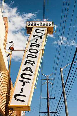 Chiropractic sign on a building - p1047m1041622 by Sally Mundy