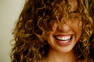 Portrait of laughing Mixed Race woman - p555m1444202 by Peathegee Inc