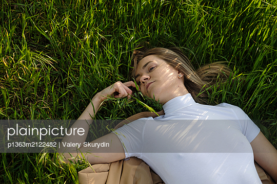Woman lies in the grass - p1363m2122482 by Valery Skurydin