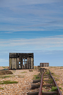 England, Kent, Dungeness. Abandoned railway track on Dungeness beach. - p652m716722 by Katie Garrod