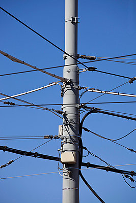 A utility pole with various wires and cables - p30119831f by Halfdark