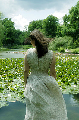 Woman at a Lily Pond - p476m758348 by Ilona Wellmann