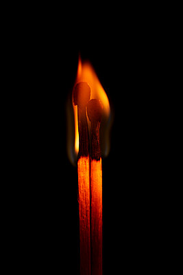 two burning matches - p1540m2185307 by Marie Tercafs