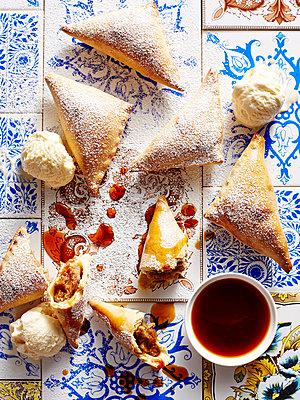 Still life of chestnut tarts with dipping sauce - p429m1012937f by BRETT STEVENS
