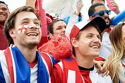 British football fans watching football match - p623m1546153 by Frederic Cirou