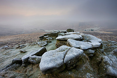 Frost covered granite outcrop on Hookney Tor, with thick fog descended over the moorland landscape, Dartmoor National Park, Devon, England, United Kingdom, Europe - p871m711374 by Adam Burton