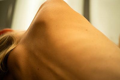 Bare shoulder of woman - p1321m2278387 by Gordon Spooner