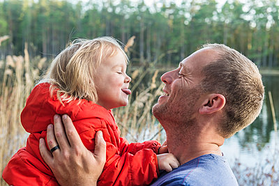 Father with daughter playing together - p312m1229020 by Fredrik Schlyter