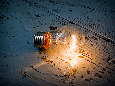Shining lightbulb - p4266187f by Tuomas Marttila