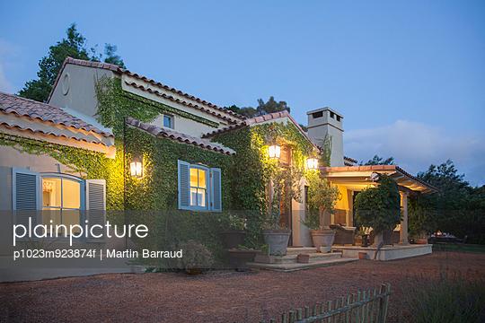Luxury villa illuminated at night - p1023m923874f by Martin Barraud