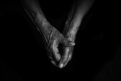 Folded hands, close-up - p1508m2168810 by Mona Alikhah