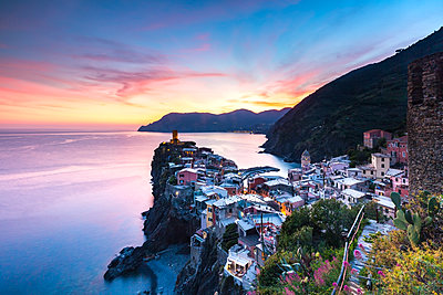 The remains of a stunning sunset over the old town and harbour of Vernazza, Cinque Terre, UNESCO World Heritage Site, Liguria, Italy, Europe - p871m1499913 by Matt Parry