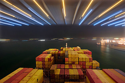 Container ship at night in Hong Kong II - p1099m857105 by Sabine Vielmo