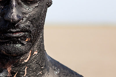 man covered by oil - p1165m956416 by Pierro Luca