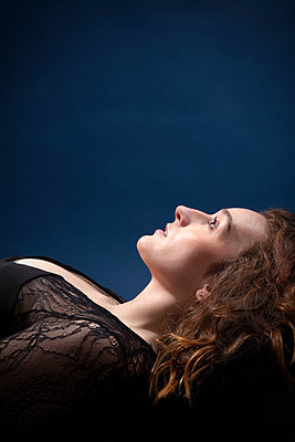 Woman Lying Down Looking  Upwards  - p1248m2063472 by miguel sobreira