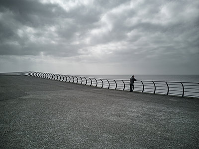 man looking out to sea - p1280m2077192 by Dave Wall