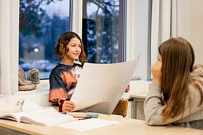 Girls sitting in classroom - p312m2174471 by Scandinav