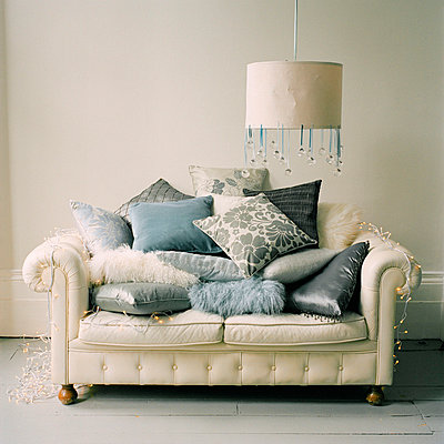 White leather chesterfield sofa piles with cushions - p349m695122 by Emma Lee