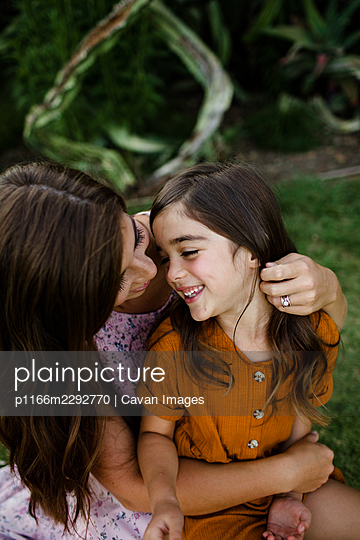 Mother & Daughter Laughing & Embracing in San Diego - p1166m2292770 by Cavan Images