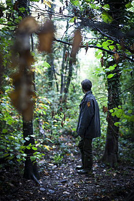 Man in a forest - p1371m1423823 by virginie perocheau