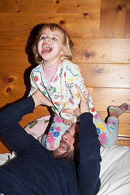 Father and daughter having fun  - p1514m2076091 by geraldinehaas