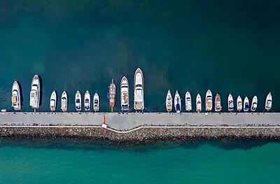 Aerial view to a yacht marina - p1596m2192882 by Nikola Spasov
