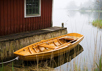 A boat by a boathouse Sweden. - p31217612f by Hans Bjurling