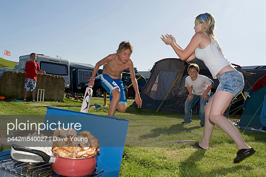 UK, England, Kids playing cricket in Freshwater Beach Holiday park on Jurassic Coast; Dorset