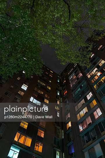 Apartment building illuminated at night, New York - p1280m2244770 by Dave Wall