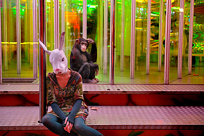 A chimpanzee and a woman with rabbit mask - p491m1119174 by Ernesto Timor